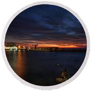 Round Beach Towel featuring the photograph a flaming sunset at Tel Aviv port by Ron Shoshani