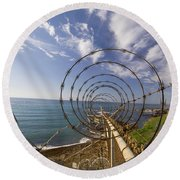A Forced Perspective View Down A Ribbon Round Beach Towel