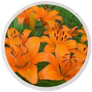 A Garden Full Of Lilies Round Beach Towel