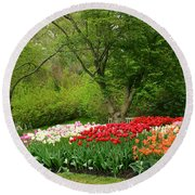 A Garden Of Tulips  Round Beach Towel by Eva Kaufman