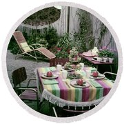 A Garden Set Up For Lunch Round Beach Towel