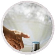 A Hand In A Playground Sprinkler Round Beach Towel