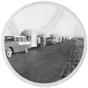 A Line Of Airstream Trailers Round Beach Towel
