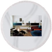 A Living Room With A Le Corbusier Chair Round Beach Towel