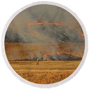 A Lone Firefighter On The Norbeck Prescribed Fire. Round Beach Towel