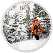 A Man Hiking Through The Snow On Mt Round Beach Towel
