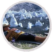 A Man Naps On A Glacier With His Hat Round Beach Towel