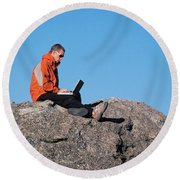A Man Uses Technology In Backcountry Round Beach Towel