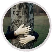 A Model Hugging A Tree Round Beach Towel