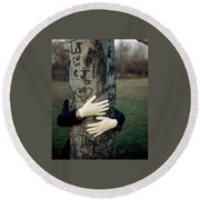 A Model Hugging A Tree Round Beach Towel