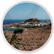 Round Beach Towel featuring the photograph A Red Flower To Lindos by Lorraine Devon Wilke