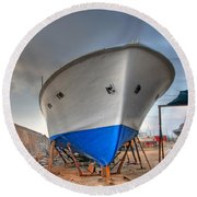 Round Beach Towel featuring the photograph a resting boat in Jaffa port by Ron Shoshani