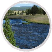 Round Beach Towel featuring the photograph A River Runs Through Yellowstone by Laurel Powell