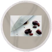A Sharp Knife And A Group Of Olives Round Beach Towel