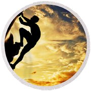 A Silhouette Of Man Free Climbing On Rock Mountain At Sunset Round Beach Towel