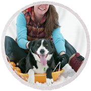 A Smiling Young Woman Rides A Sled Round Beach Towel