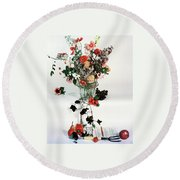 A Studio Shot Of A Vase Of Flowers And A Garden Round Beach Towel