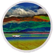 Round Beach Towel featuring the photograph A Surreal Ride by Susan Wiedmann