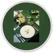 A Table Setting On A Green Tablecloth Round Beach Towel