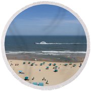 A Touring Speedboat Passes By Shore In Ocean City Maryland Round Beach Towel