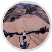 A View Of A Female Mountain Bikers Round Beach Towel