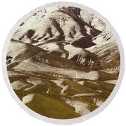 A View Of A Mountainside With Melting Round Beach Towel
