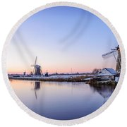 Round Beach Towel featuring the photograph A Cold Winter Morning With Some Windmills In The Netherlands by IPics Photography