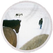 A Woman Tries To Round Up Lone Horse Round Beach Towel