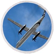 Round Beach Towel featuring the photograph Alaska Airlines Turboprop Wide Version by Aaron Berg