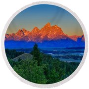 Alpenglow Across The Valley Round Beach Towel