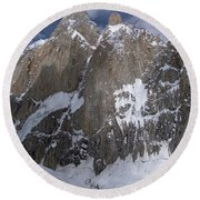 Alpinist On The Unclimbed North Face Round Beach Towel