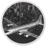 American Dc-6 Flying Over Nyc Round Beach Towel