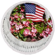 Round Beach Towel featuring the photograph American Flag With Flowers by Joan Reese