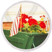 American Flags And Geraniums In A Wheelbarrow Two Round Beach Towel by Marian Cates