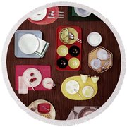 An Assortment Of Dinnerware Round Beach Towel