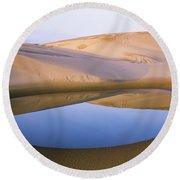An Ephemeral Pond Mirrors The Umpqua Round Beach Towel