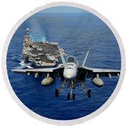 Round Beach Towel featuring the photograph An Fa-18 Hornet Demonstrates Air Power. by Paul Fearn