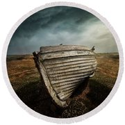An Old Wreck On The Field. Dramatic Sky In The Background Round Beach Towel