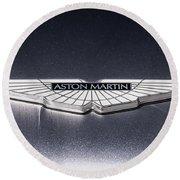 Round Beach Towel featuring the digital art Aston Martin Badge by Douglas Pittman