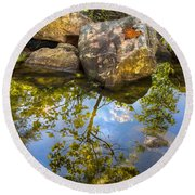 At The River Round Beach Towel