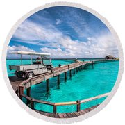 Baggy On The Jetty Over The Blue Lagoon Round Beach Towel