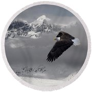 Bald Eagle Soars Above The Snow And Ice Round Beach Towel