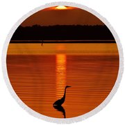 Bayside Ripples - A Heron Takes An Evening Stroll As The Sun Sets Behind The Clouds On The Bay Round Beach Towel