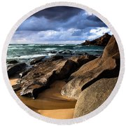 Between Rocks And Water Round Beach Towel