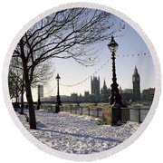 Big Ben Westminster Abbey And Houses Of Parliament In The Snow Round Beach Towel by Robert Hallmann