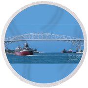 Blue Water Bridge And Freighters Round Beach Towel