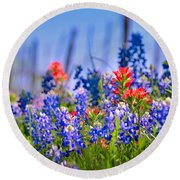Round Beach Towel featuring the photograph Bluebonnet Paintbrush Texas  - Wildflowers Landscape Flowers Fence  by Jon Holiday