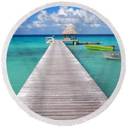 Boats At The Jetty In A Tropical Turquoise Lagoon Round Beach Towel