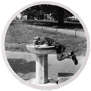 Boy Drinking From Fountain Round Beach Towel
