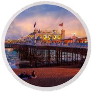 Round Beach Towel featuring the photograph Brighton's Palace Pier At Dusk by Chris Lord